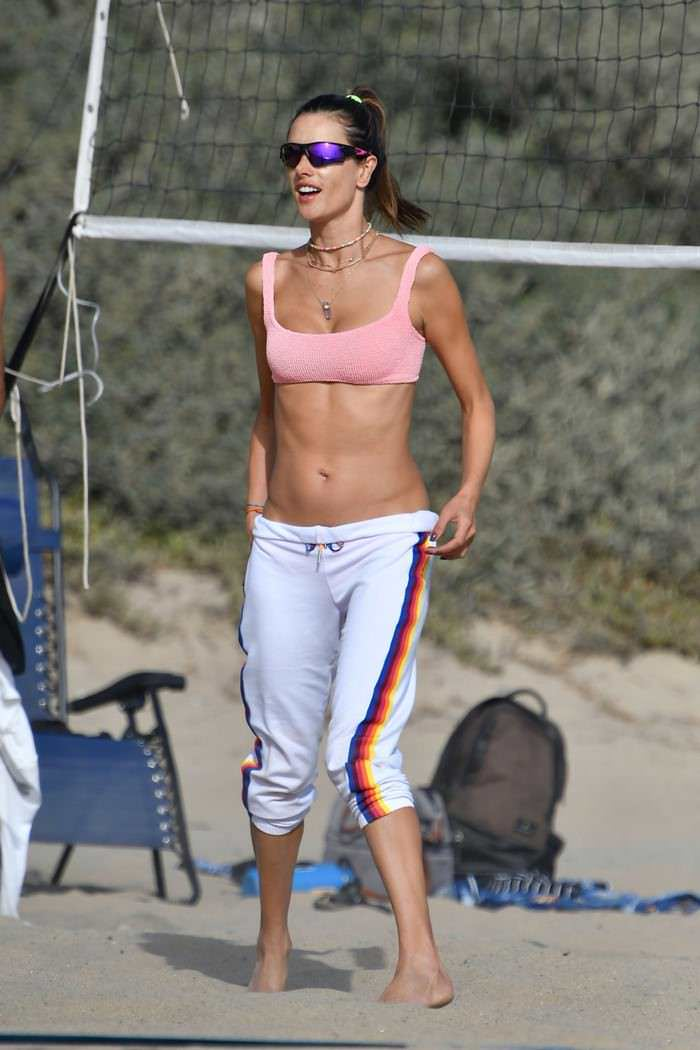 Alessandra Ambrosio in a Warm Pink Bikini Top Plays Beach Volleyball