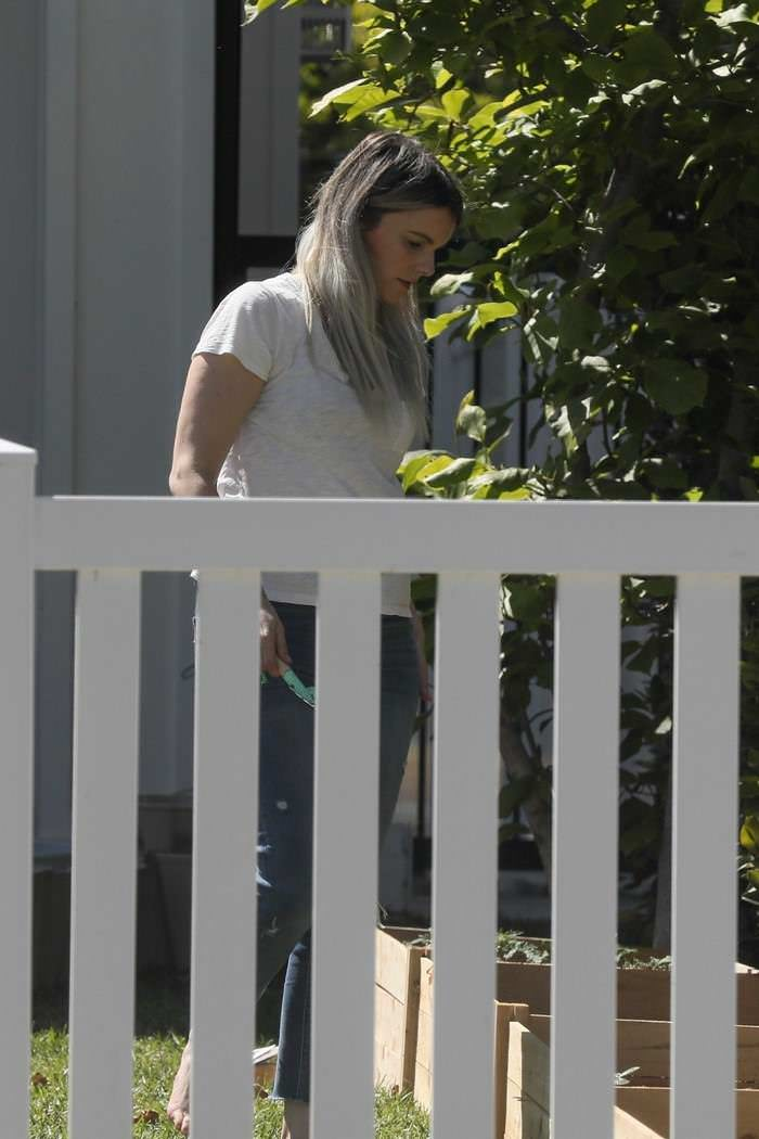 Ali Fedotowsky Gardening on a Sunny Day at Home in the Garden