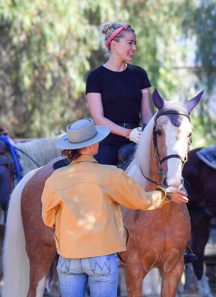 Amber Heard Enjoys with her GF on the Ranch while Petition Against Her is Growing