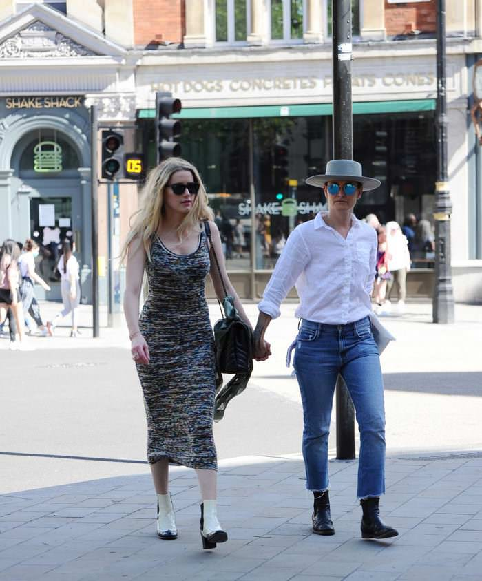Amber Heard Walks with her GF After .3 Million Libel Trial with Johnny Depp