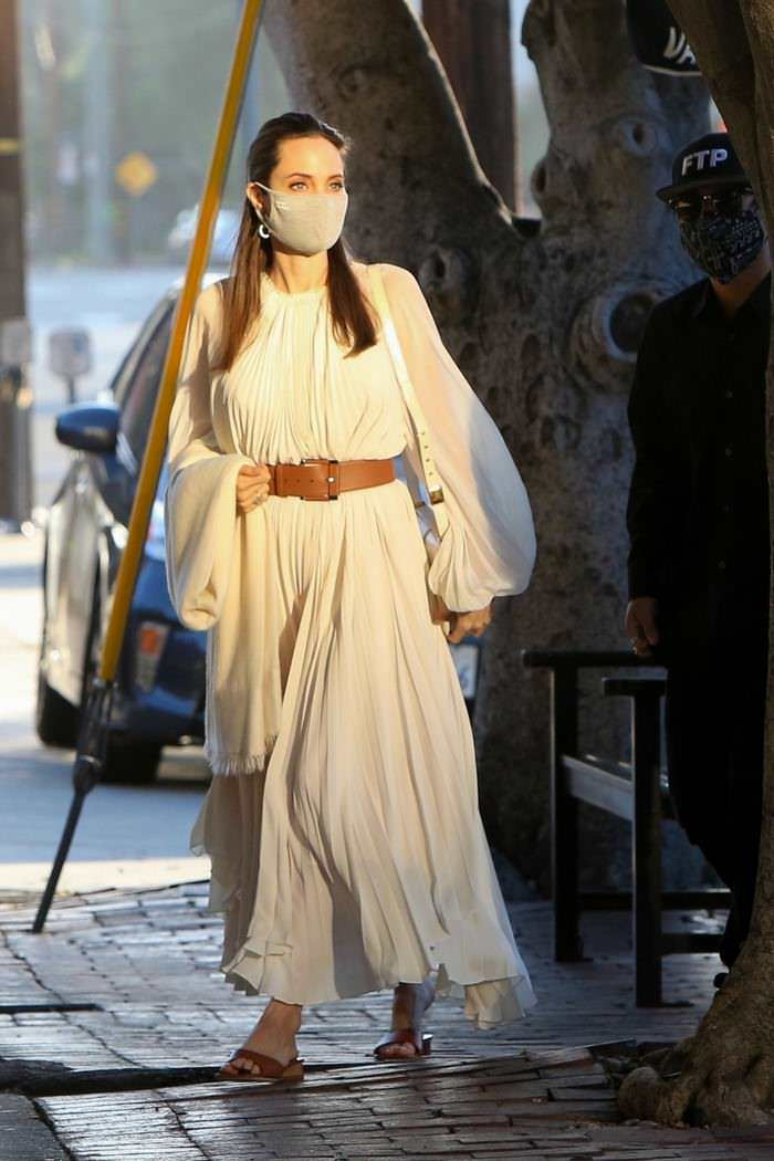 Angelina Jolie Looks Divine in Cream Dress as She Steps Out for Lunch