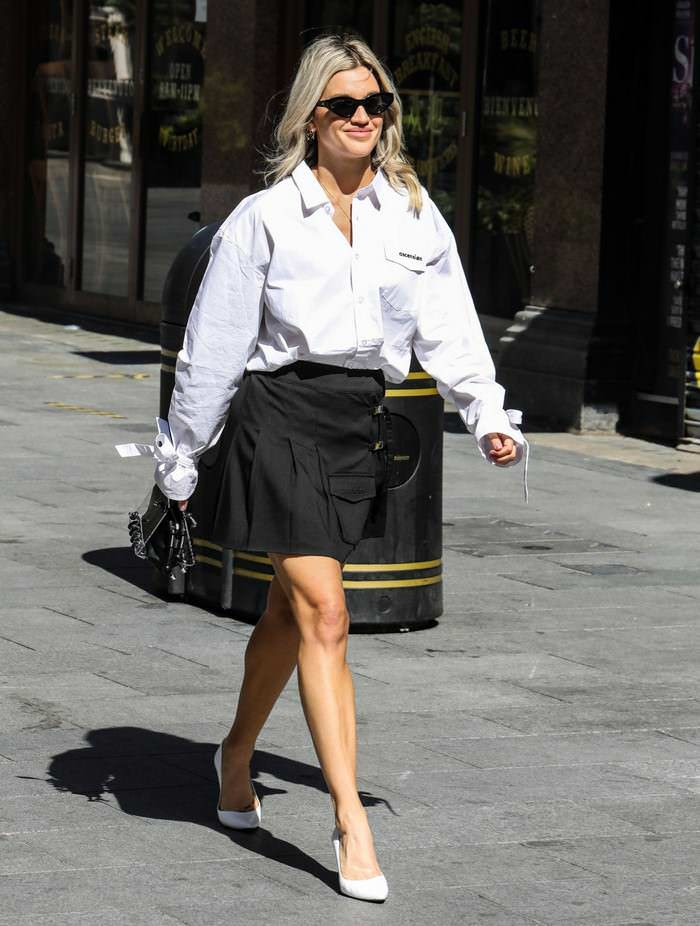Ashley Roberts in a Slogan-printed White Shirt and Black Mini Skirt