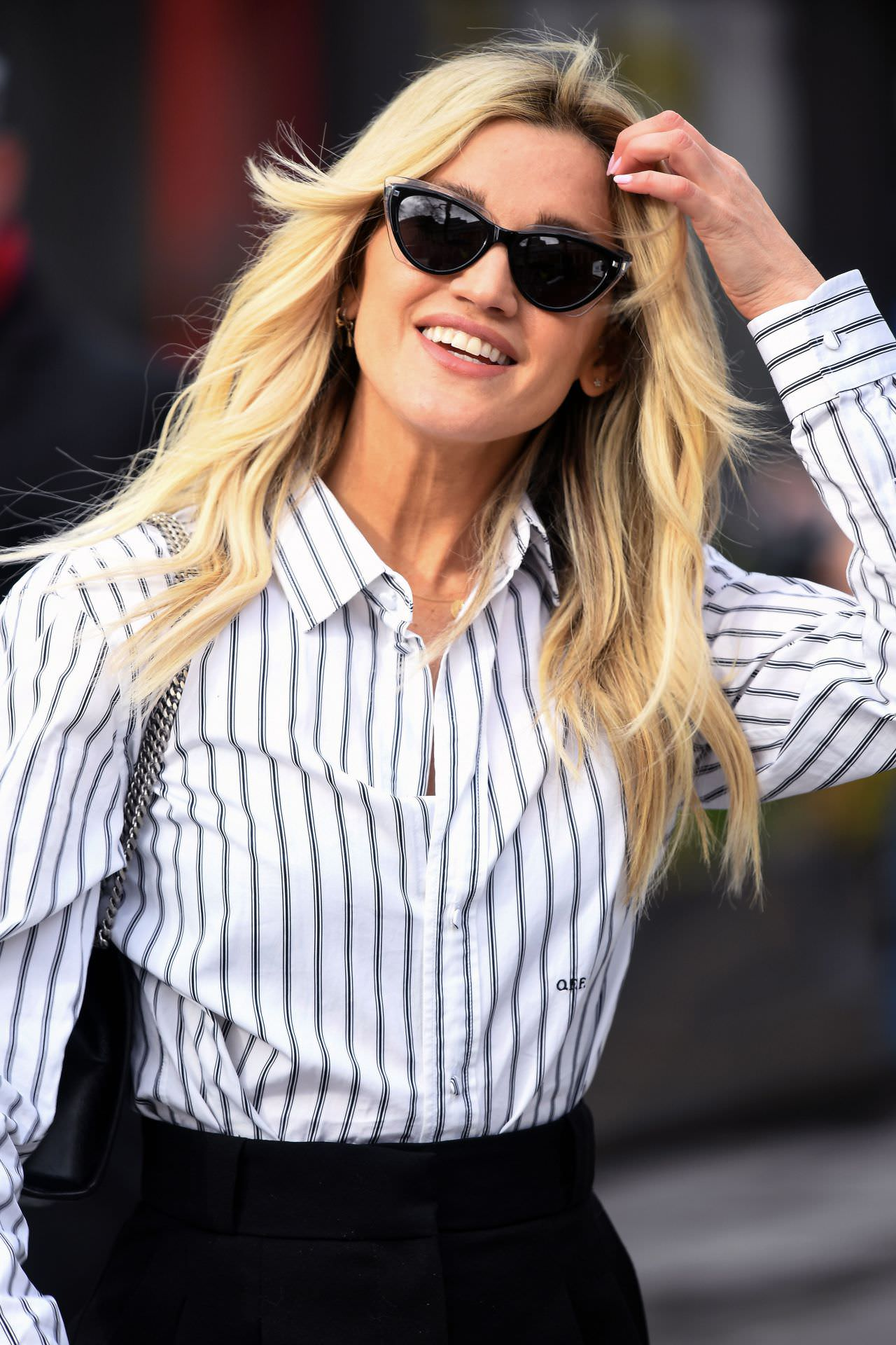 Ashley Roberts is Chic in a Striped Blouse and Black Pants