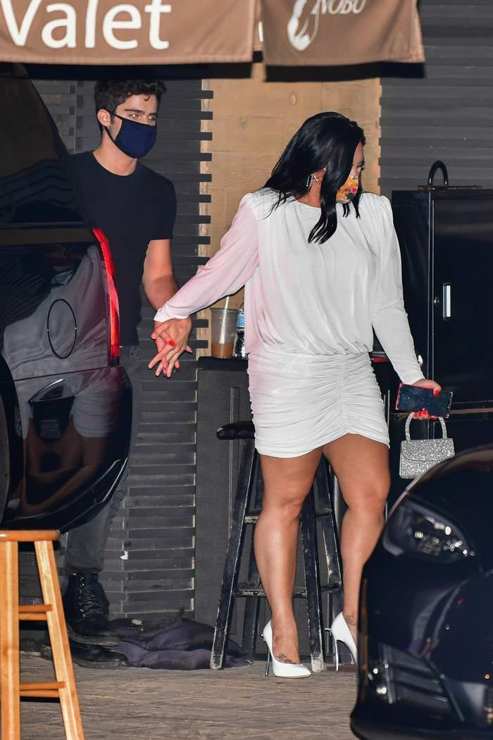 Demi Lovato in All White Celebrate an Engagement with Her Husband-to-be
