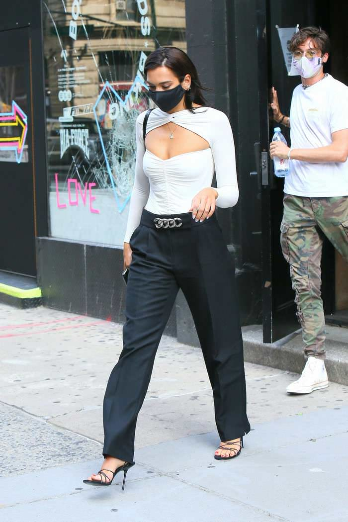 Dua Lipa in a Chic White Cut-out Bodysuit Leaves a Studio in NY