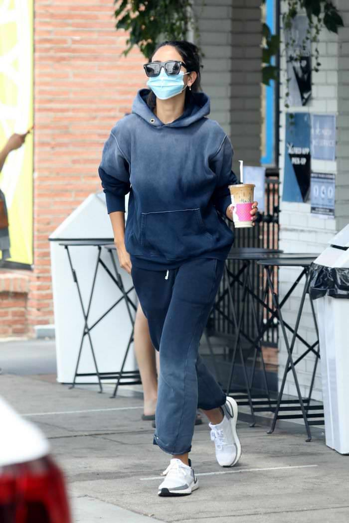 Eiza González run out in baggy blue bleached sweats for coffee in LA