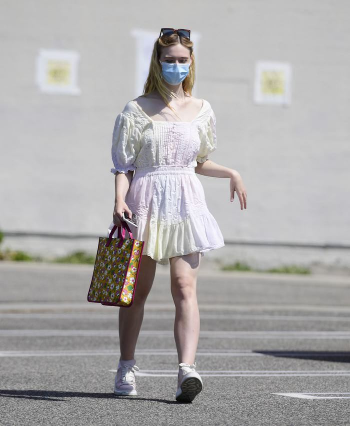 Elle Fanning Looking Cute in a Frilly Pastel Dress During a Grocery Run