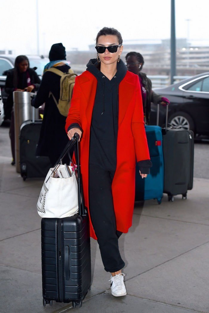 Emily Ratajkowski in Red Overcoat with Casual Sweats at JFK Airport