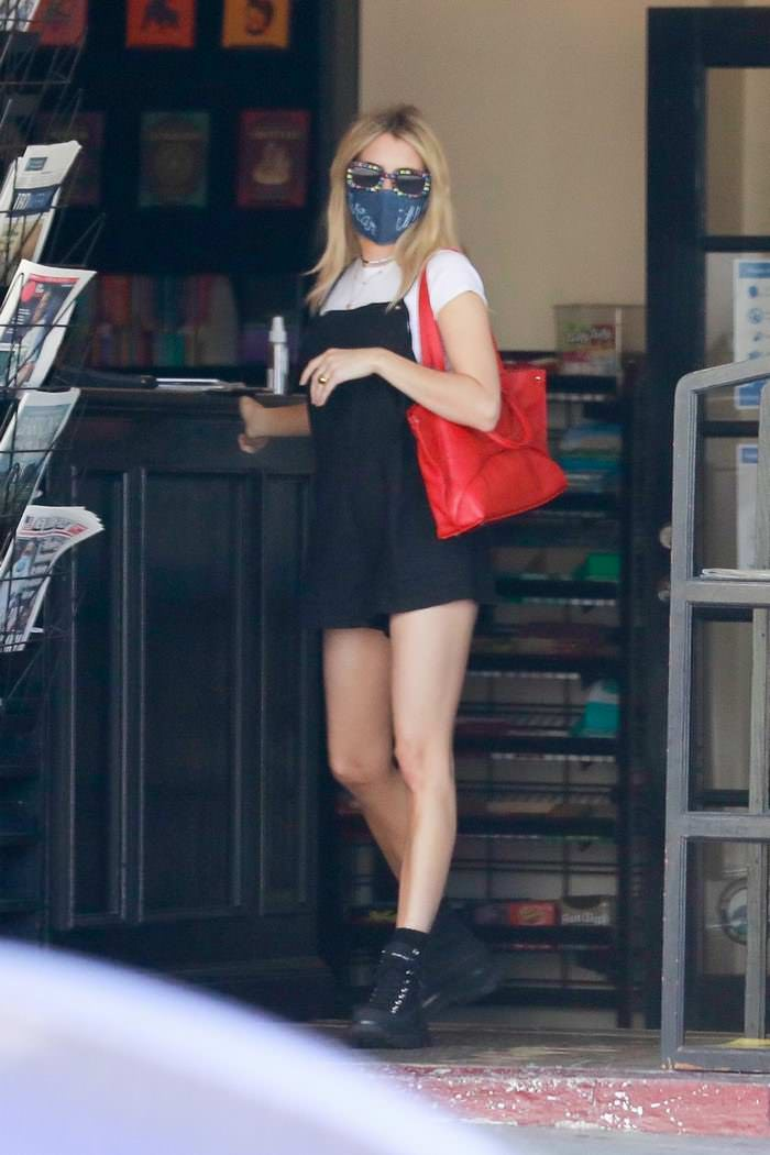 Emma Roberts in a Chic Black Dress During Coffee Run