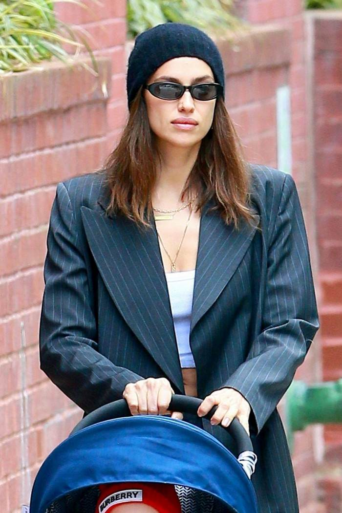 Irina Shayk Out for a Stroll in a White Crop Top and Chic Charcoal Suit
