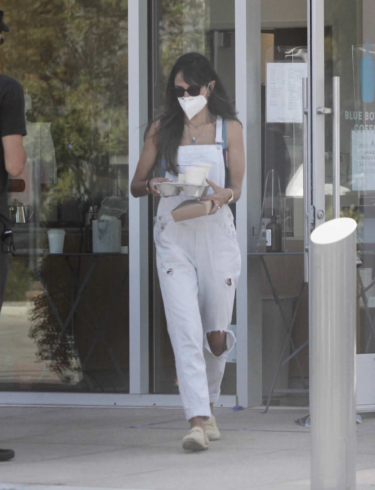 Jordana Brewster Does a Coffee Run in Distressed White Overalls