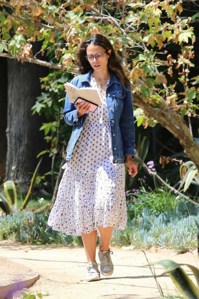 Jordana Brewster Reads a Book While Walking in Brentwood