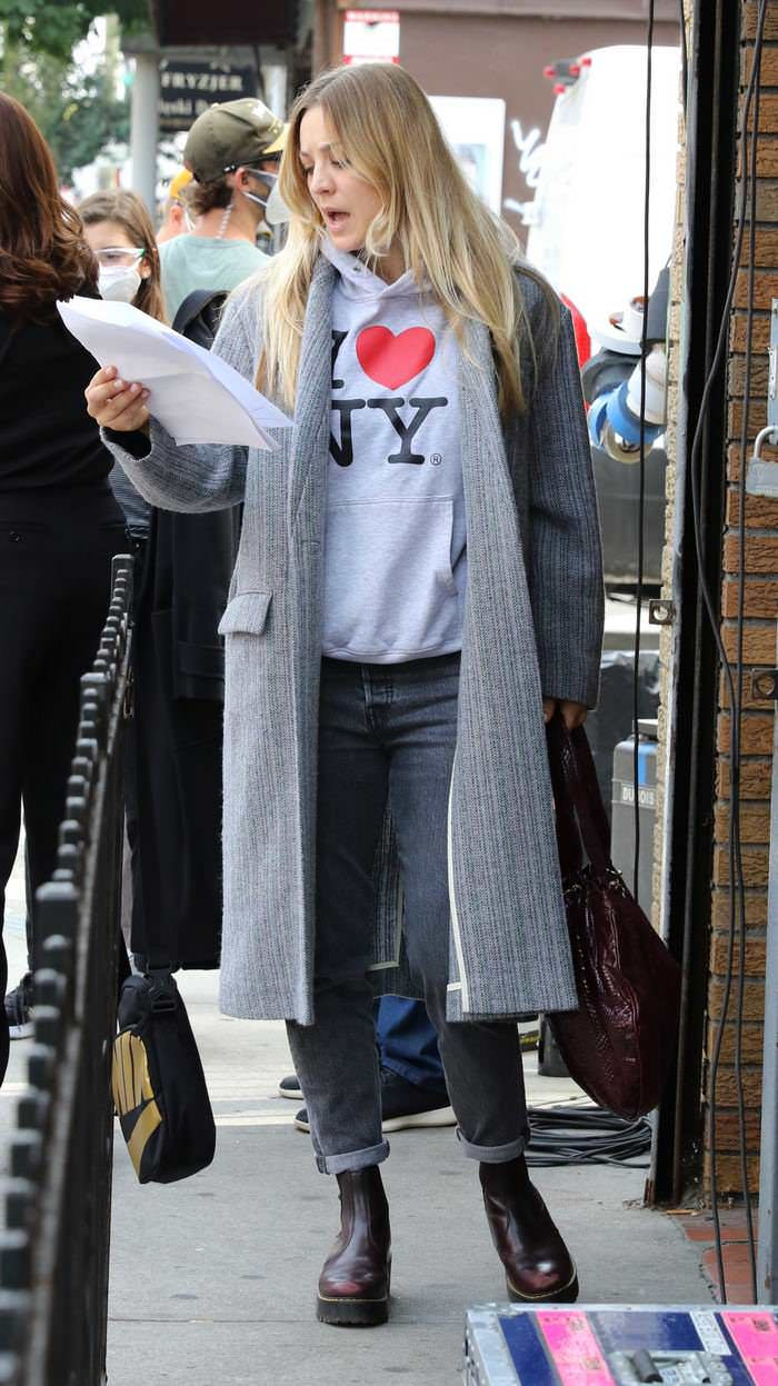 "Kaley Cuoco in ""I Love NY"" White Hoodie on the Set of The Flight Attendant"