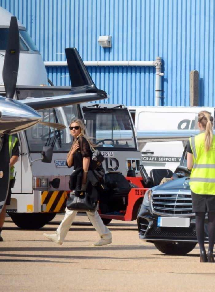 Kate Moss at Luton Airport Trying to Fly Out of the Country