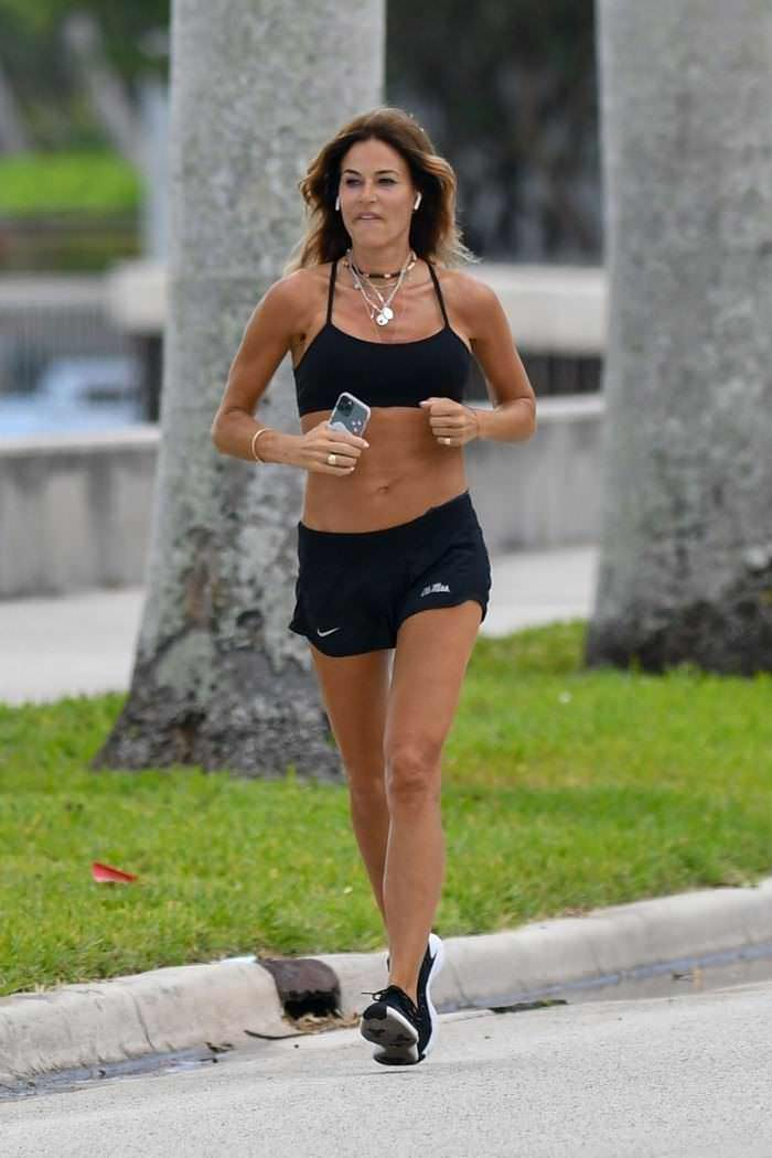 Kelly Bensimon Jogging in a Black Top and Shorts in Palm Beach