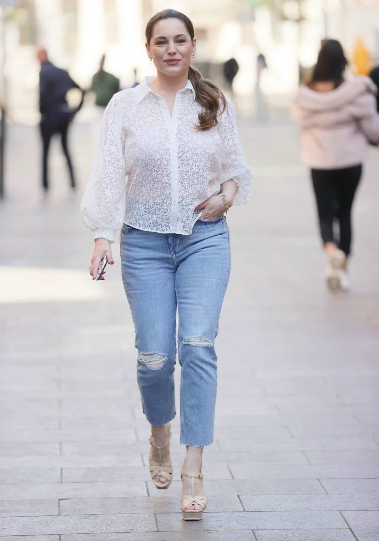 Kelly Brook in a Semi-sheer Floral Blouse and Denim