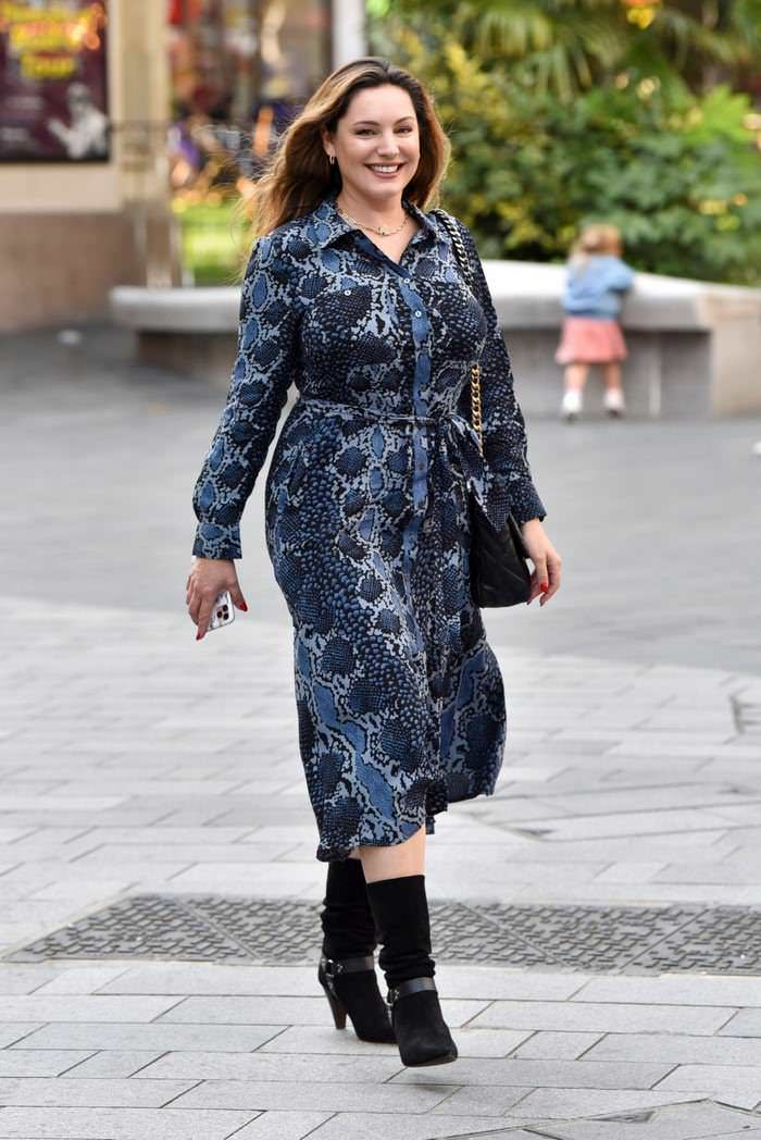 Kelly Brook Looked Effortlessly Chic in a Blue Snakeskin Print Midi Dress