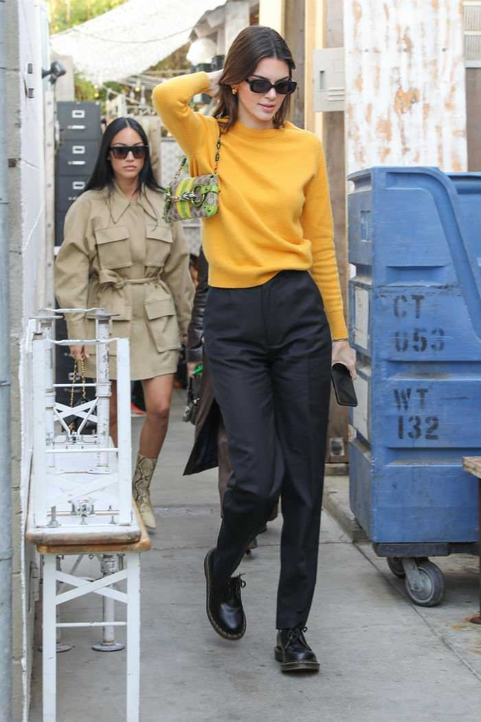 Kendall Jenner in a Black Pants & Yellow Sweater Out in Venice