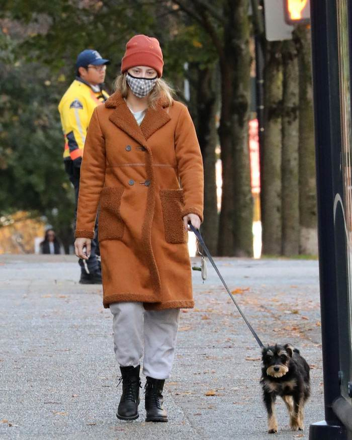 Lili Reinhart in the Brown Fleece-lined Coat Takes her Dog for a Walk in Vancouver