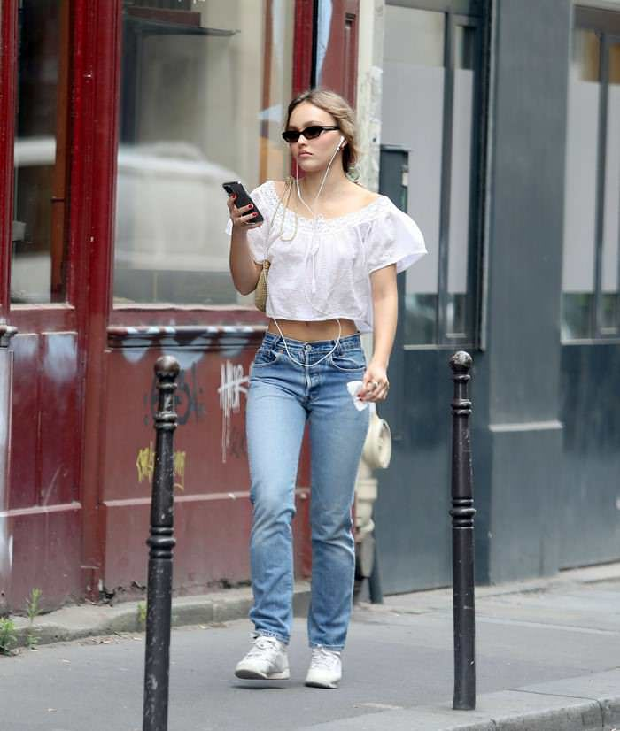Lily-Rose Depp Hits a Casual Figure in Blue Jeans and a Crop Top