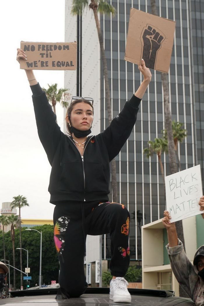 Madison Beer Protests with a Sign 'No freedom til we're equal'