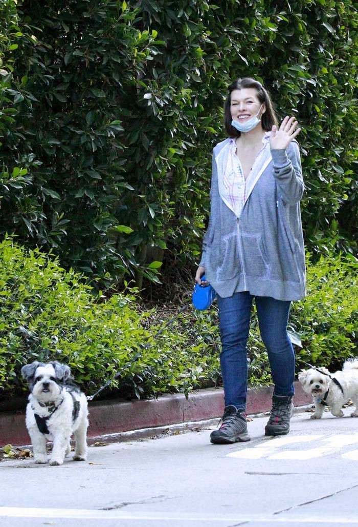 Milla Jovovich Cuts a Relaxed Look as She Takes Her Dogs For a Walk