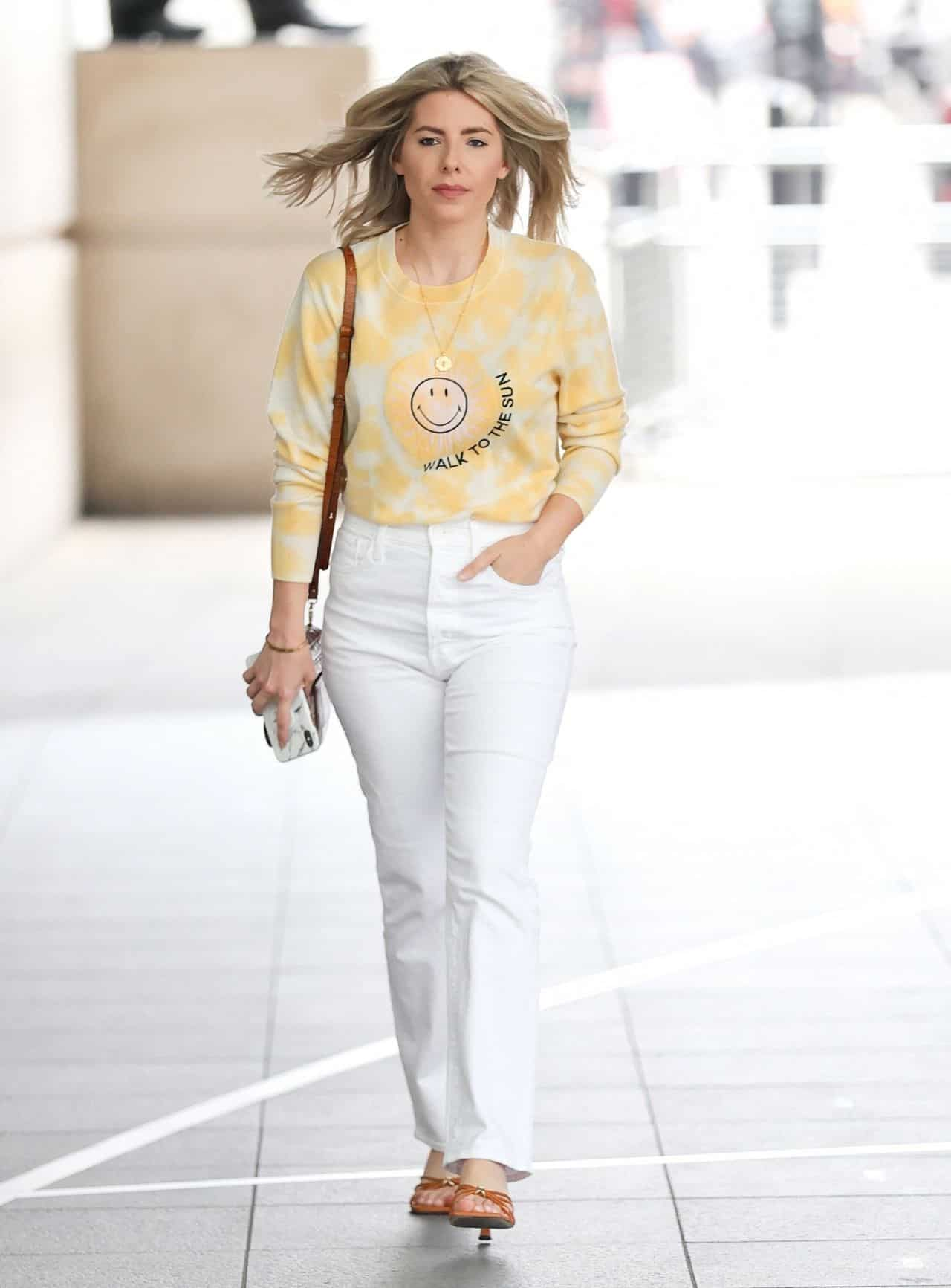 Mollie King Wears Yellow Sweater and White Jeans on her Way to BBC Radio 1