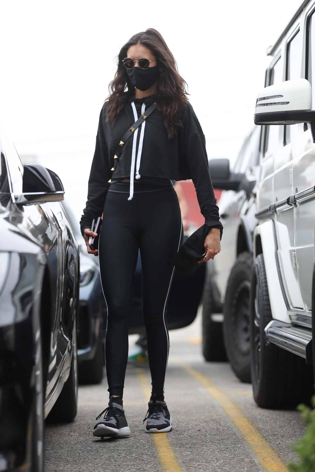 Nina Dobrev Showcases her Svelte Figure in a Black Outfit