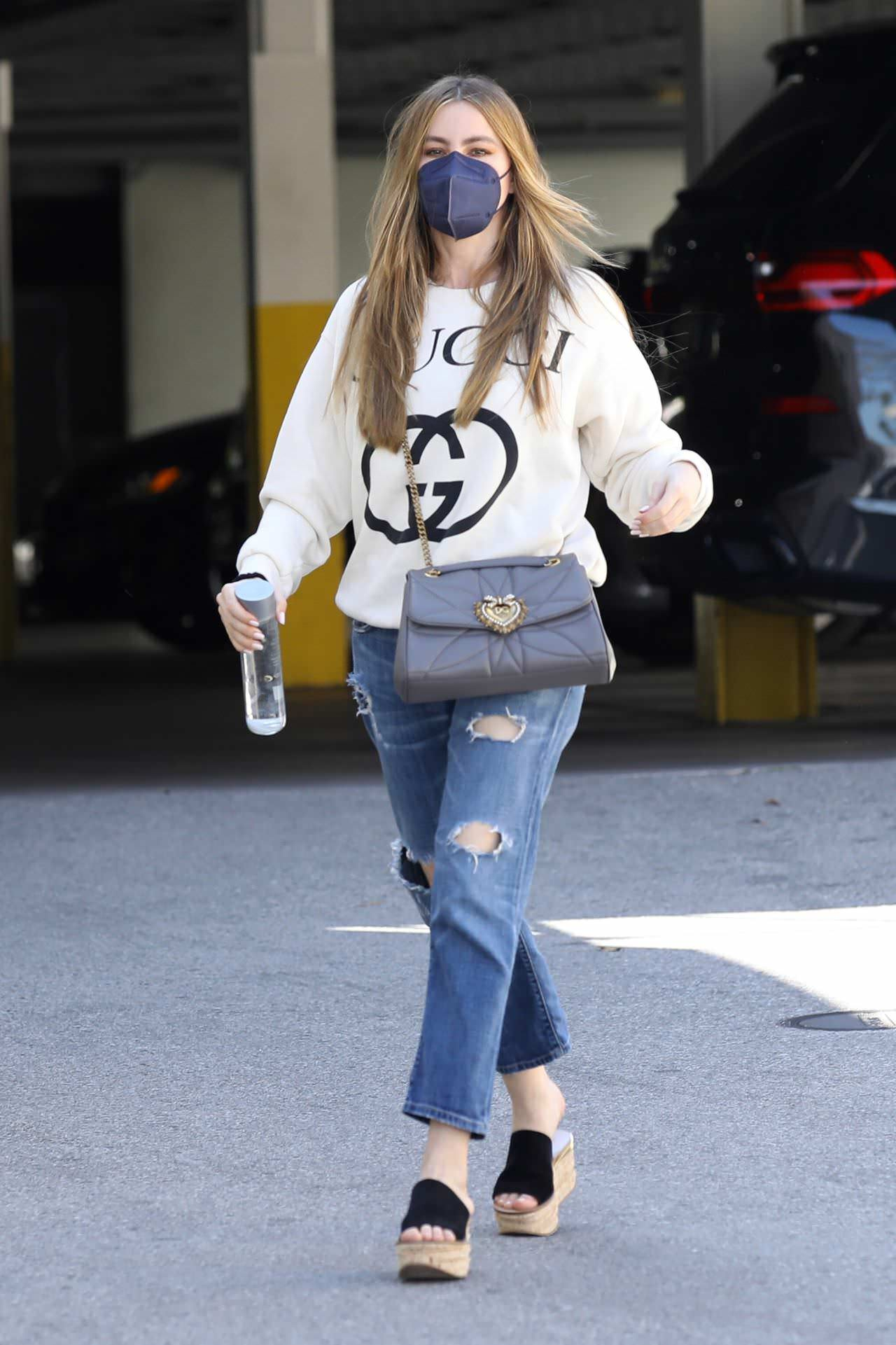 Sofia Vergara Running Errands in Gucci Sweater and Blue Jeans