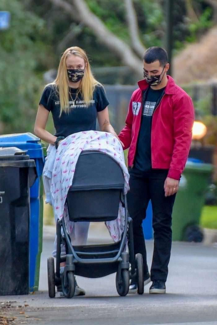 Sophie Turner And Joe Jonas Walk With Their Baby Girl Around Their Neighborhood
