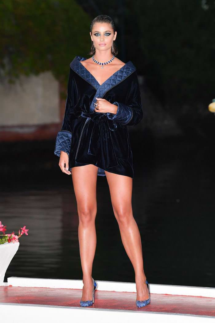 Taylor Hill Puts on a Leggy Display in a Mini Velvet Wrap Dress at 77th Venice Film Festival