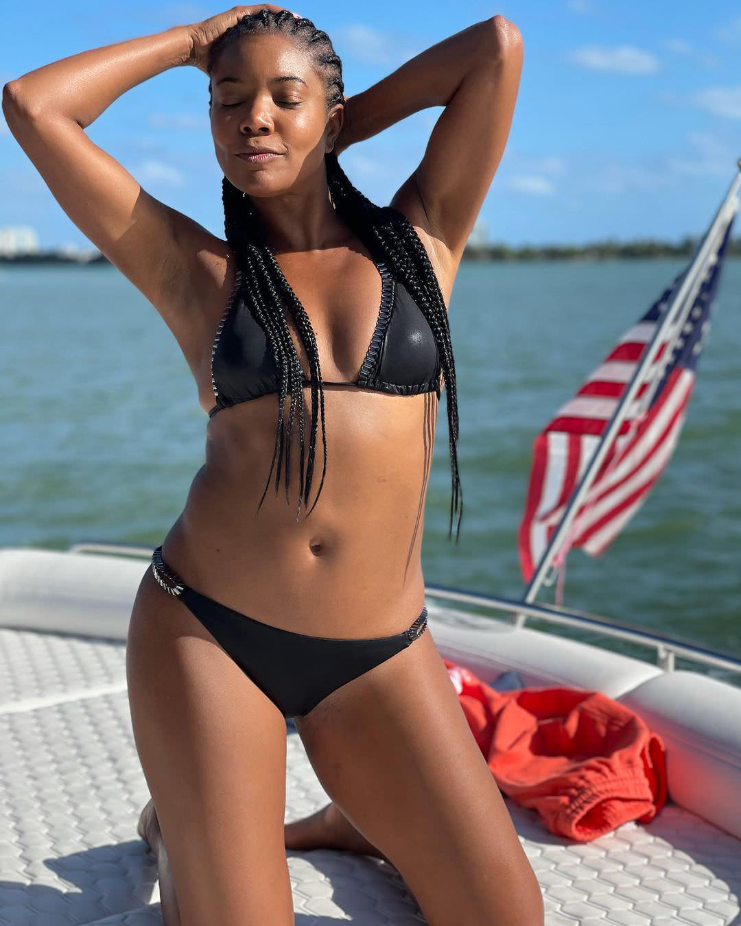 The L.A.'s Finest star beamed in a simple but pricey black chain-trimmed Moeva bikini.