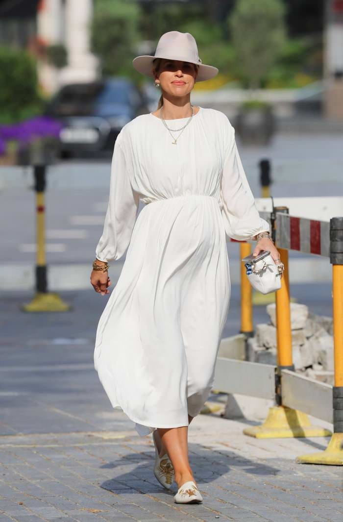 Vogue Williams Displays her Baby Bump in Chic White Dress