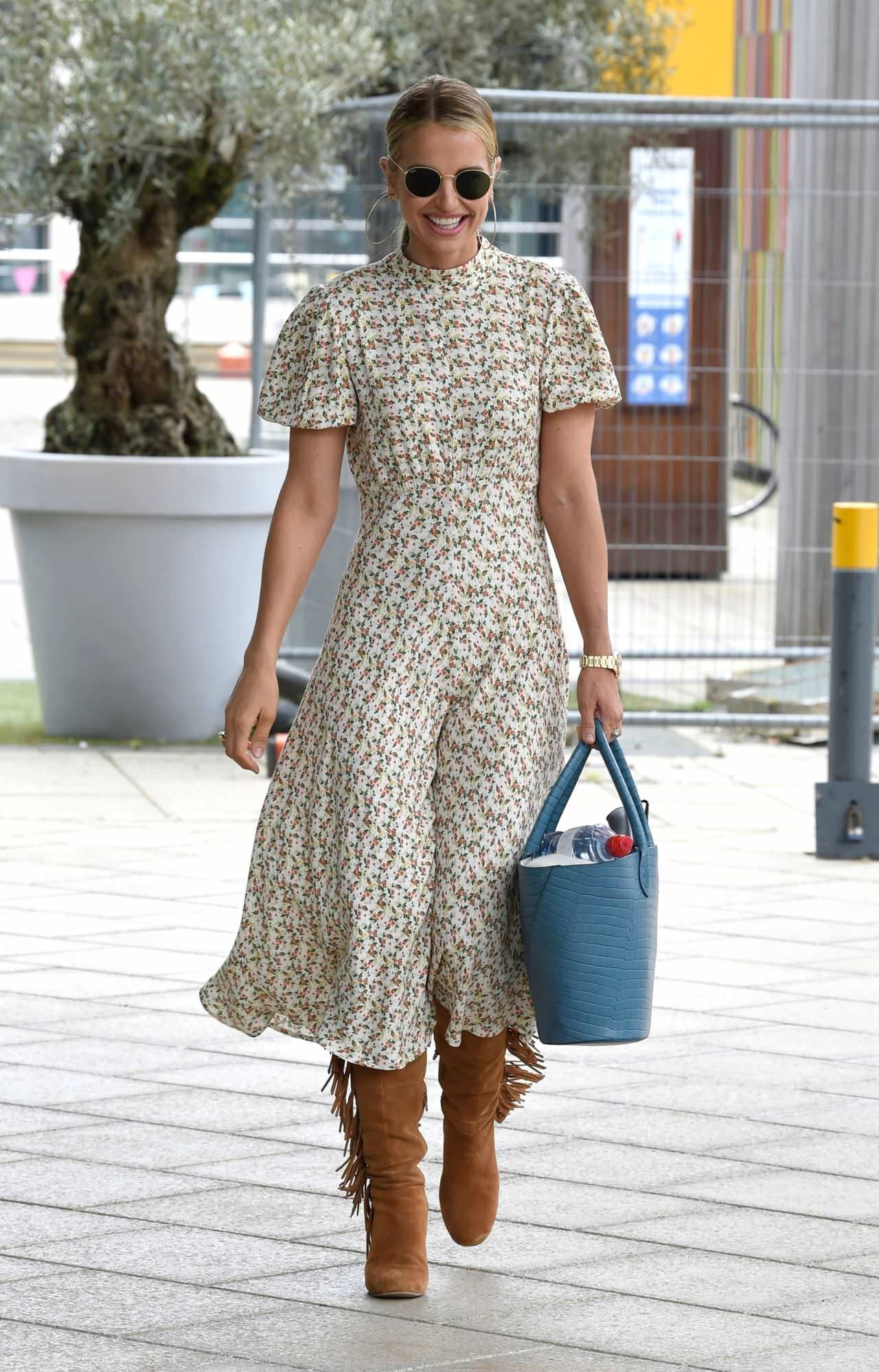 Vogue Williams Steps Out in a Floral Print Dress in Leeds