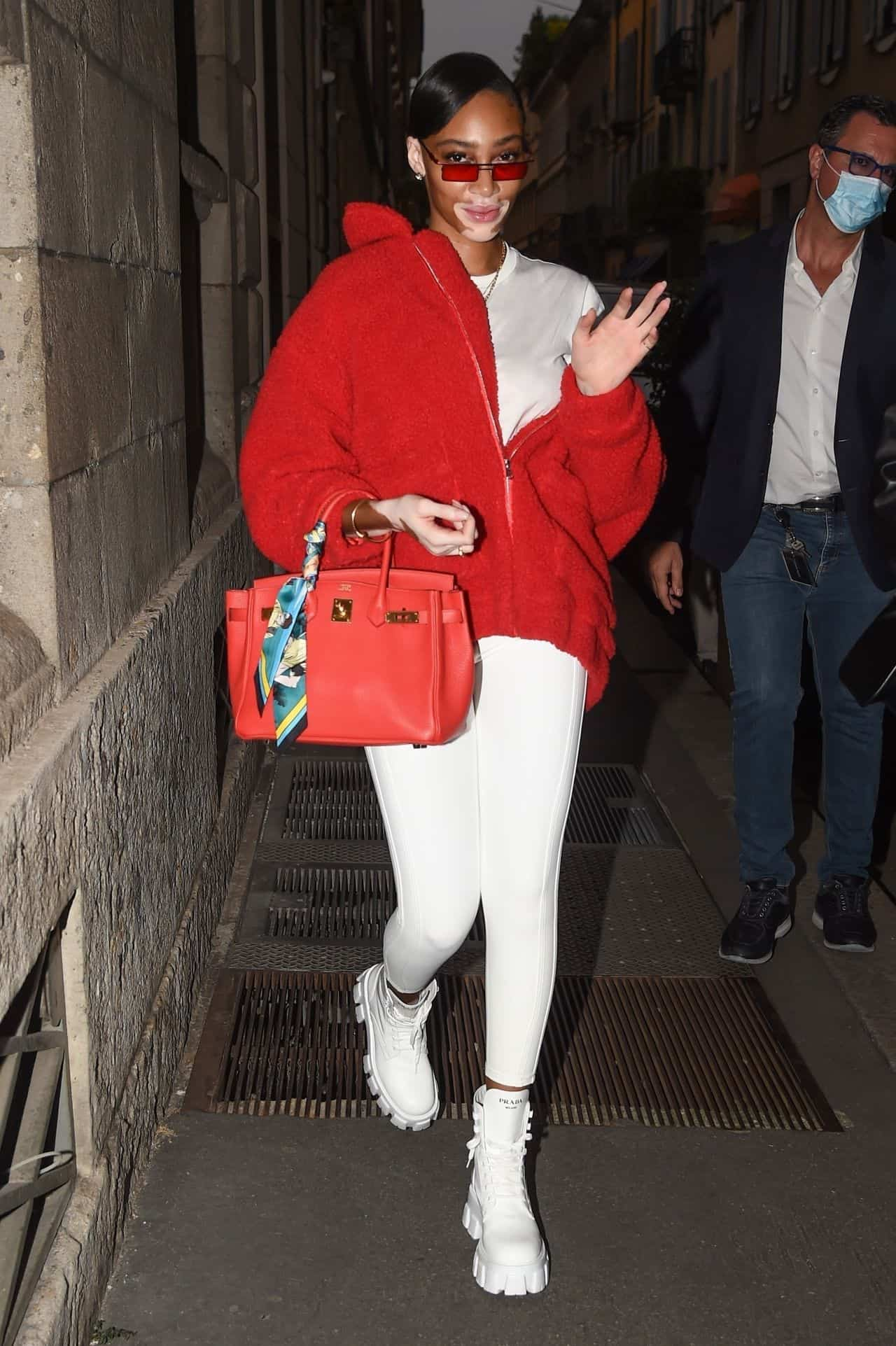 Winnie Harlow Wore a White Outfit with a Red Jacket at Milan Fashion Week