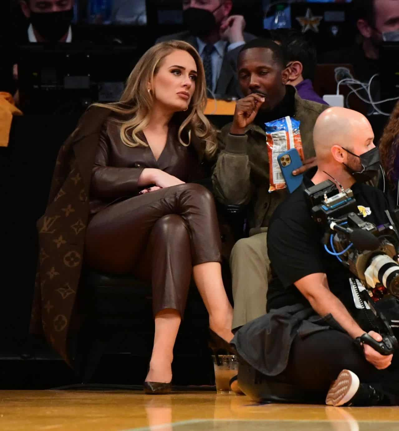 Adele in a Skin-tight Leather Outfit Beside her Boyfriend at an NBA Game