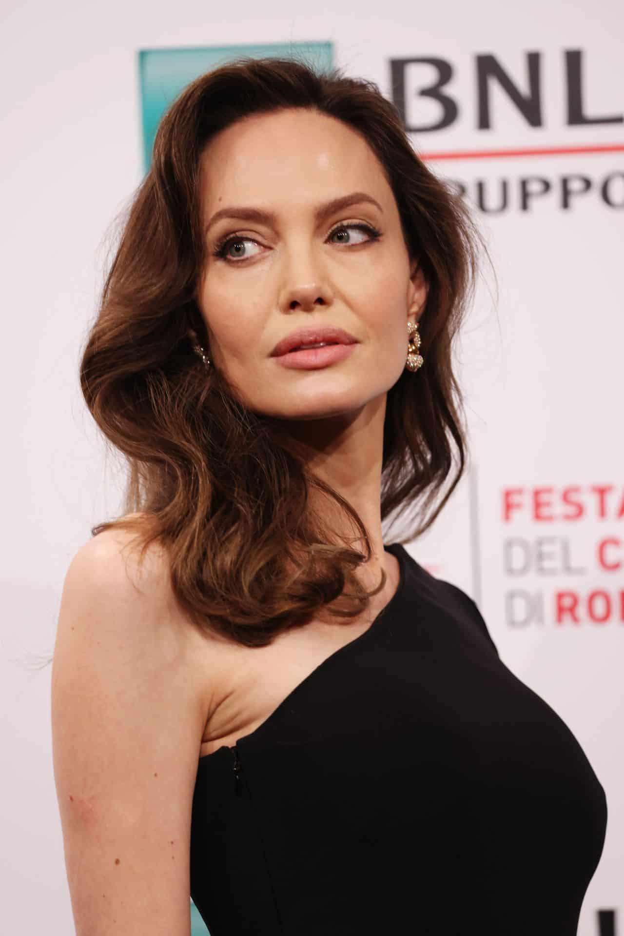 """Angelina Jolie Stuns in One-shoulder Black Dress at """"Eternals"""" Photocall"""