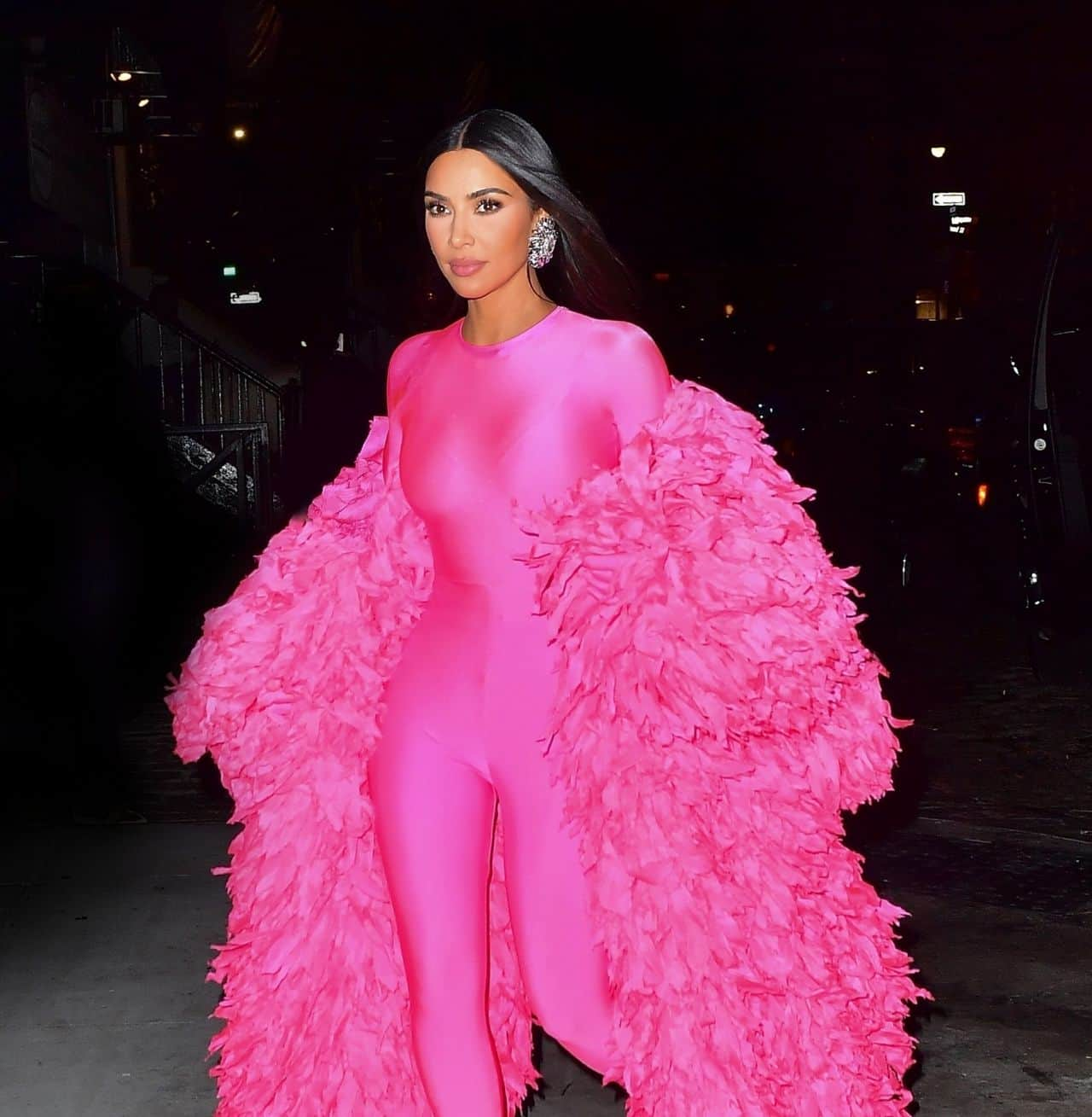Kim Kardashian Looks Stunning in a Hot Pink Feathered Catsuit