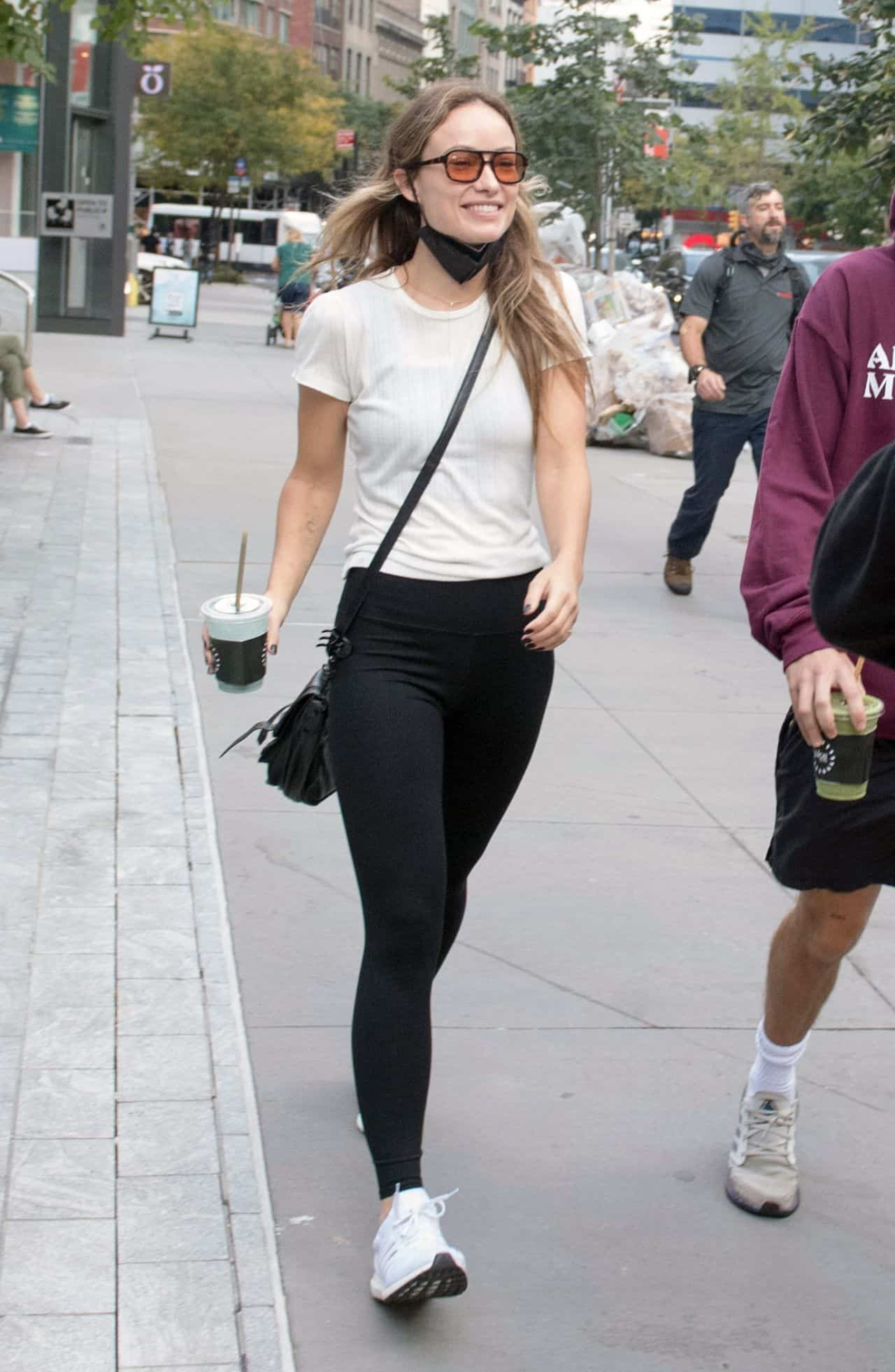 Olivia Wilde Smiles Happily as she Walks with Harry Styles in NYC